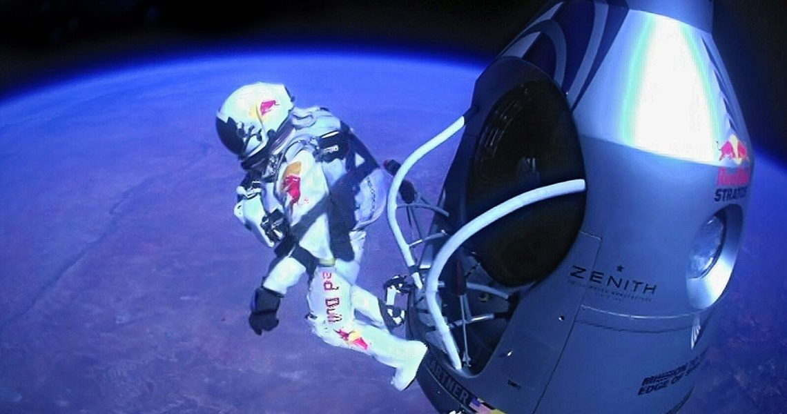 Pilot Felix Baumgartner of Austria jumps out of the capsule during the final manned flight for Red Bull Stratos in Roswell, New Mexico in this October 14, 2012 handout photo. Baumgartner was attempting to break a 52-year-old record by skydiving from 23 miles (37 km). He also attempted to break the sound barrier while in freefall. REUTERS/Jay Nemeth/Red Bull Stratos Content Pool/Handout    (UNITED STATES - Tags: SCIENCE TECHNOLOGY TRANSPORT SOCIETY TPX IMAGES OF THE DAY) NO SALES. NO ARCHIVES. FOR EDITORIAL USE ONLY. NOT FOR SALE FOR MARKETING OR ADVERTISING CAMPAIGNS. THIS IMAGE HAS BEEN SUPPLIED BY A THIRD PARTY. IT IS DISTRIBUTED, EXACTLY AS RECEIVED BY REUTERS, AS A SERVICE TO CLIENTS