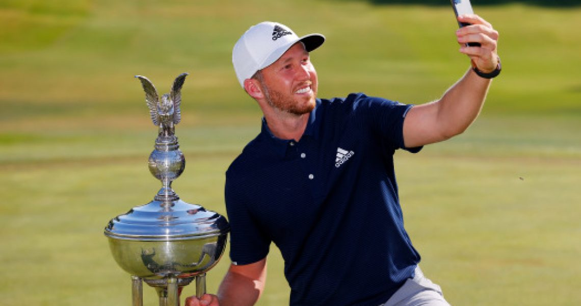 FORT WORTH, TEXAS - JUNE 14: Daniel Berger of the United States takes a selfie as he celebrates with the Leonard Trophy after defeating Collin Morikawa of the United States in a playoff during the final round of the Charles Schwab Challenge on June 14, 2020 at Colonial Country Club in Fort Worth, Texas. (Photo by Tom Pennington/Getty Images)
