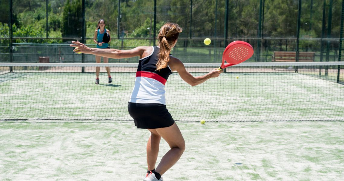 Two women playing padel outdoor
